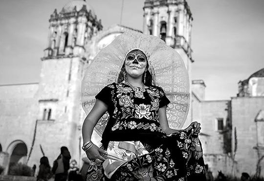 A woman dressed up for Dia De Los Muertos