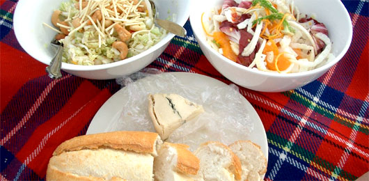 A bowl of food on a table, with Picnic