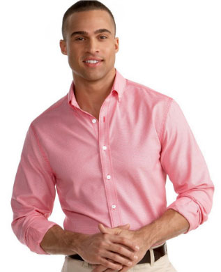 A man wearing a pink shirt