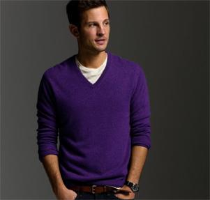 A man wearing a purple sweater