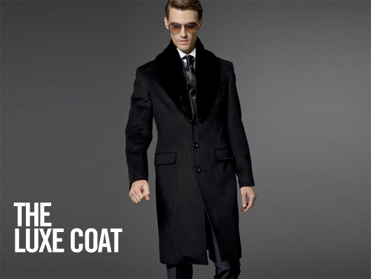 A man wearing a suit and tie the luxe coat