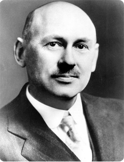 Robert H. Goddard wearing a suit and tie
