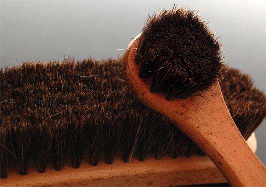 A close up of a shoe shine brush