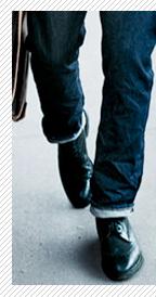A man wearing cuffed jeans