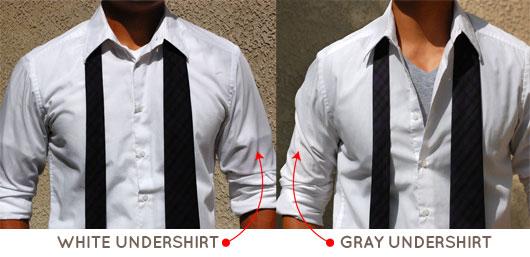 A man wearing a white undershirt next to a man wearing a gray undershirt