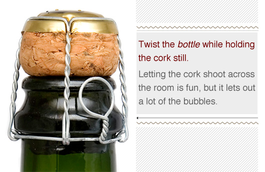 Close of a champagne cork - twist the bottle while holding the cork still