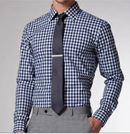 A man wearing a tie and gingham shirt