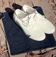 White sneakers and shoe bag
