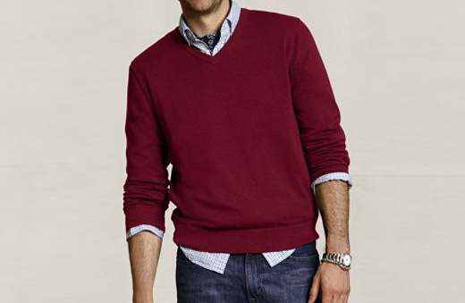A man wearing a red sweater