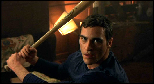 Joaquin Phoenix with bat