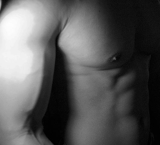A close up of a muscular man