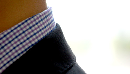Close up of shirt and suit collar