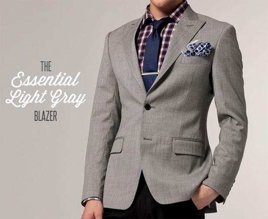 A man wearing a light gray blazer