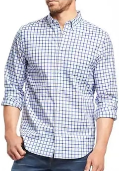 A person standing posing for the camera in a check shirt