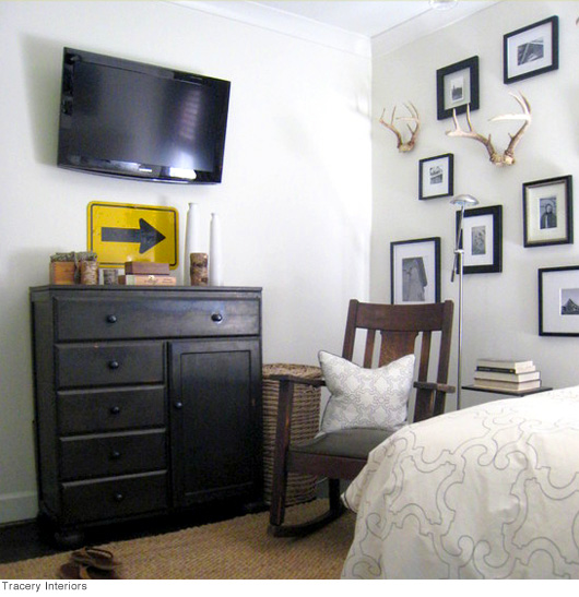 A bedroom filled with furniture and a flat screen tv