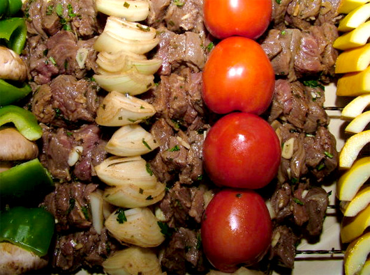 A pile of food, with Skewer and vegetables
