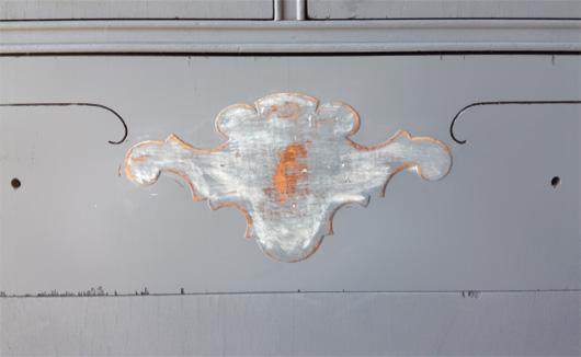 Distressed decoration on dresser