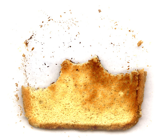 A close up of a piece of half eaten bread