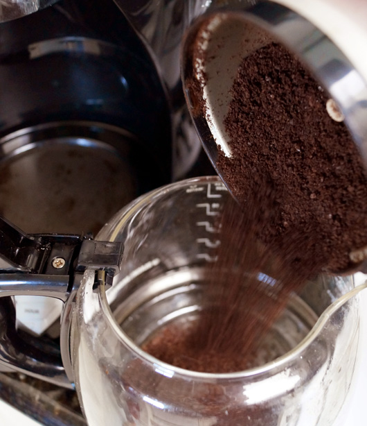 Putting coffee in coffemaker