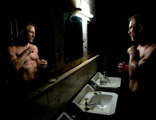 Daniel Craig looking in mirror