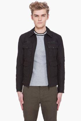 A man wearing a trucker jacket