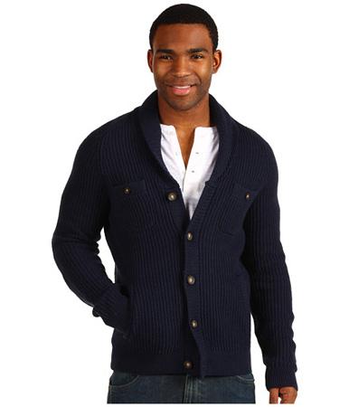 A person wearing a shawl collar cardigan