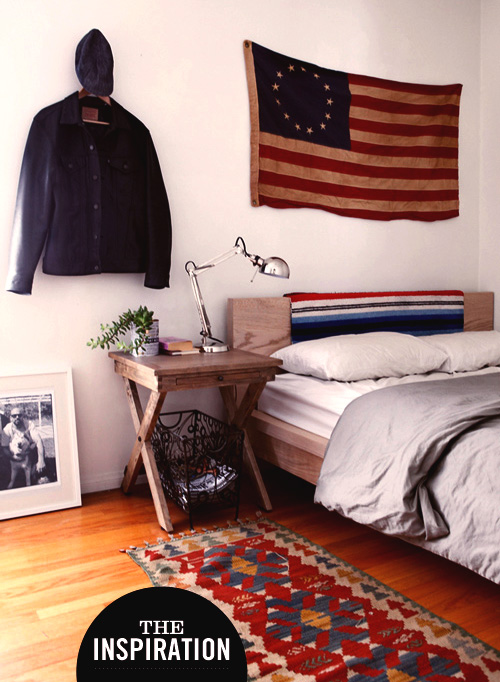 A bedroom with a flag