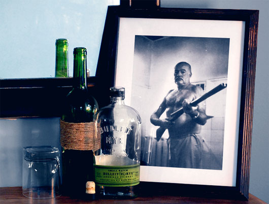 Ernest Hemingway photo in frame with bottles