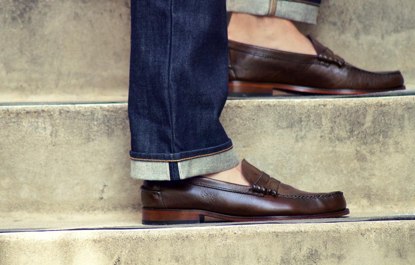 Man wearing jeans with loafers