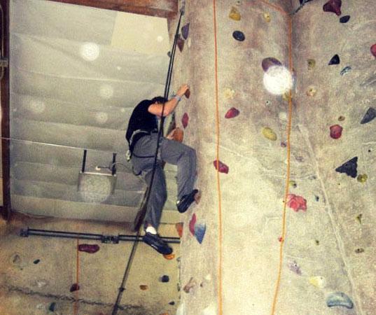 A man climbing a rock wall