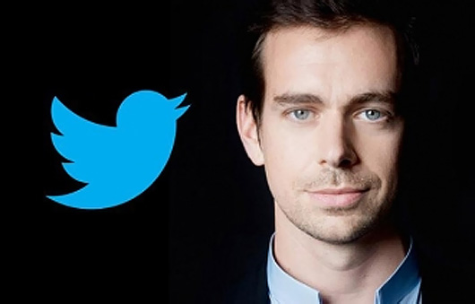 Jack Dorsey wearing a suit and tie looking at the camera