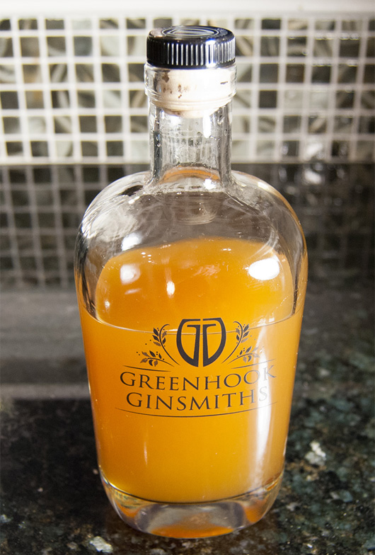 Combining the ingredients for homemade bitters