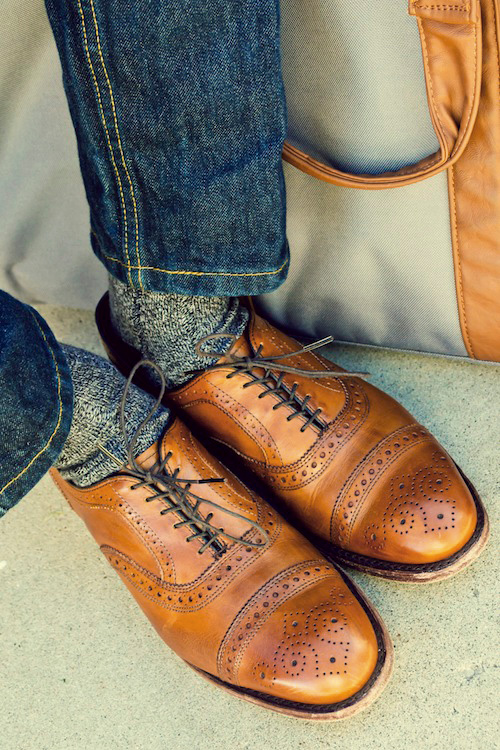 A man wearing Allen Edmonds Strands shoes with jeans