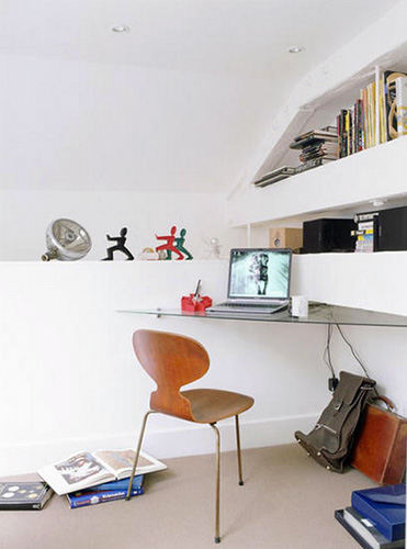 A corner desk with chair