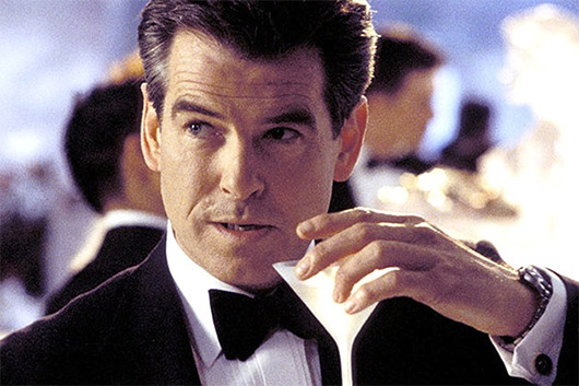 Pierce Brosnan wearing a suit and tie