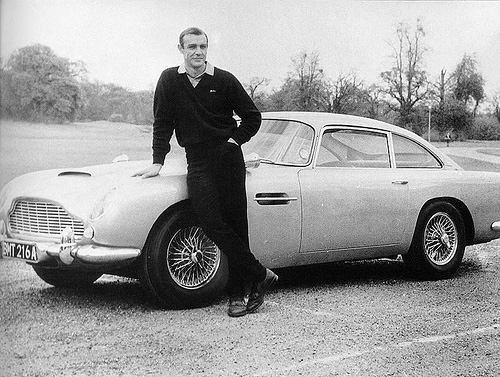 Sean Connery standing next to car
