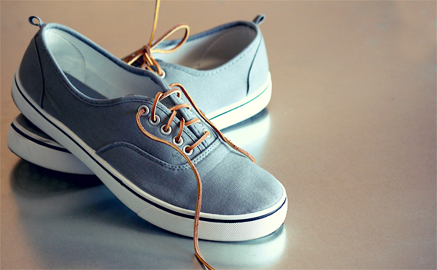 A pair of canvas shoes with leather laces