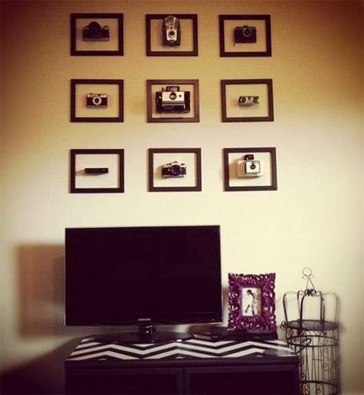 Cameras in frames on wall