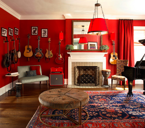 A red living room with guitars