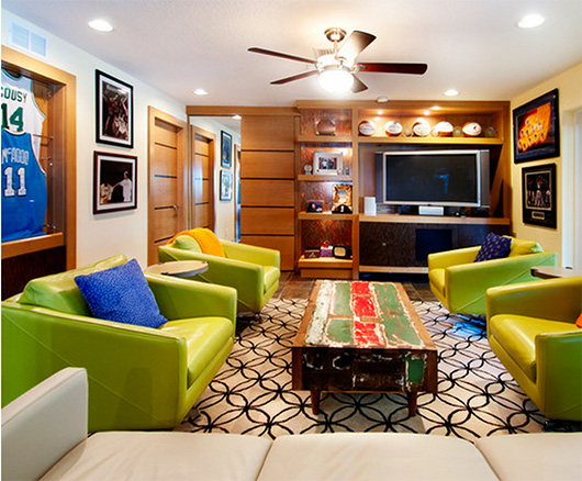 A living room with green chairs