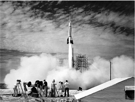 People watching a rocket launch