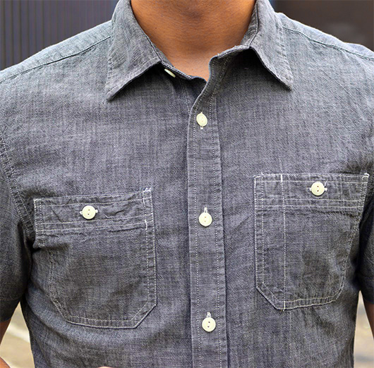 The medium blue chambray shirt is one of those classic menswear staples that never seems to go out of style.. If you could only own casual button up shirts, a blue chambray shirt should definitely be one of them. It's kind of like the light blue OCBD, but slightly less preppy and more rugged.