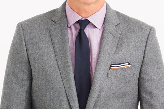 A man wearing a suit and tie