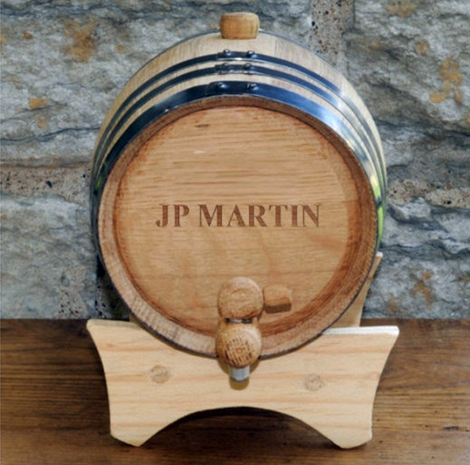 A barrel sitting on top of a wooden table