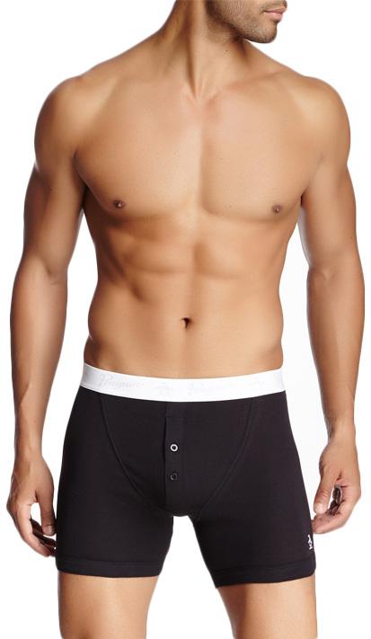 A person modeling black underwear