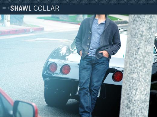 Man leaning on car in shawl collar sweater