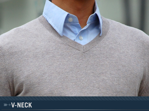 A man wearing a v neck sweater without a tie