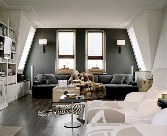 A uniquely shaped room with gray wall