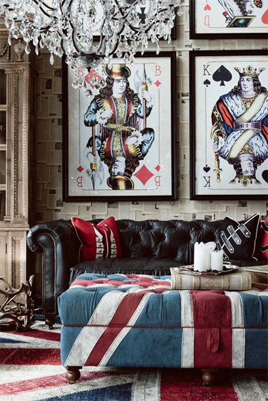 Playing card wall art with leather couch