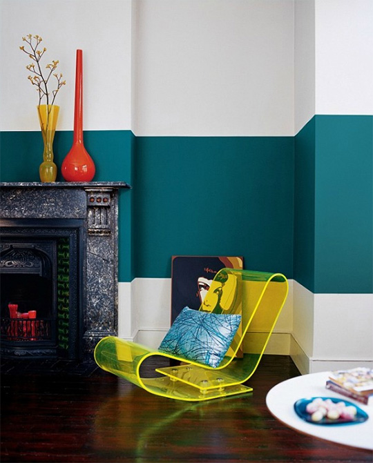 Room with teal stripe on wall